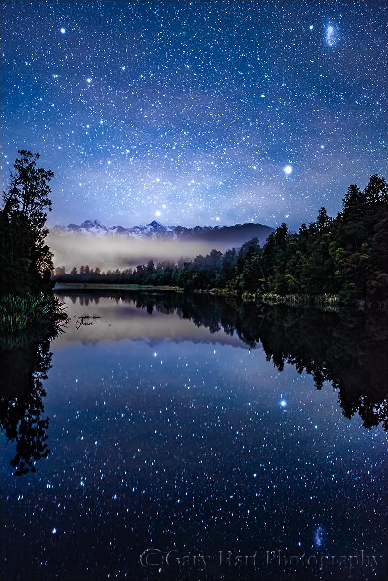 night sky reflection lake matheson new zealand eloquent images
