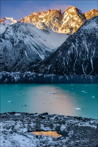 Reflection on the Rocks, Nun's Veil and Tasman Lake, New Zealand